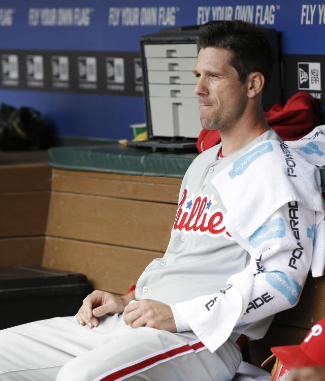 Philadelphia Phillies starting pitcher Cliff Lee sits in the dugout during the second inning of an opening day baseball game against the Texas Rangers at Globe Life Park, Monday, March 31, 2014, in Arlington, Texas. (AP Photo/Tony Gutierrez)
