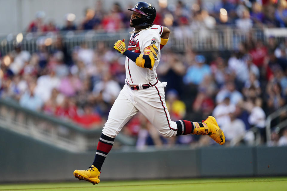 Atlanta Braves' Ronald Acuna Jr. runs to second base after hitting a double in the first inning of the team's baseball game against the Boston Red Sox on Wednesday, June 16, 2021, in Atlanta. (AP Photo/John Bazemore)