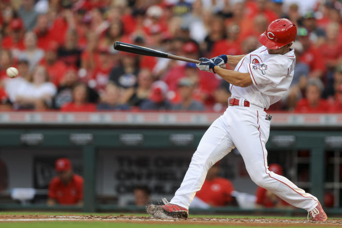Cincinnati Reds' Shogo Akiyama hits a grounder that resulted in a run scored and a force out during the second inning of the team's baseball game against the Milwaukee Brewers in Cincinnati, Saturday, July 17, 2021. (AP Photo/Aaron Doster)