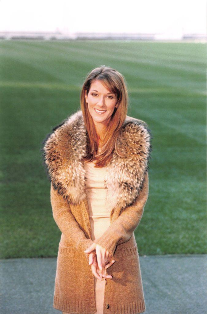 <p>Celine looked extra cozy in this autumn portrait. Her nude dress complements the long caramel cardigan, and we suddenly find ourselves wishing for fall.</p>