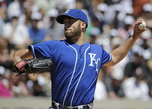 Kansas City Royals starter Danny Duffy throws against the Chicago White Sox during the first inning of a baseball game in Chicago on Saturday, June 14, 2014. (AP Photo/Nam Y. Huh)