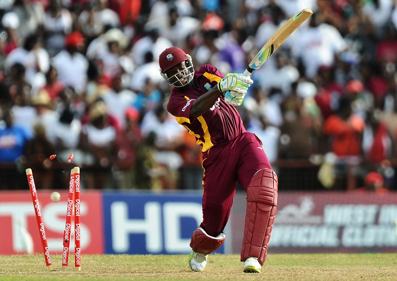 The wicket of West Indies cricketer Andre Russell is seen dislodged off a no-ball delivery by Australian cricket team stand-in captain Shane Watson during the third-of-five One Day International (ODI) matches between West Indies and Australia at the Arnos Vale Ground in Kingstown on March 20, 2012. Australia have scored 220/10 at the end of their innings.    AFP PHOTO/Jewel Samad (Photo credit should read JEWEL SAMAD/AFP/Getty Images)