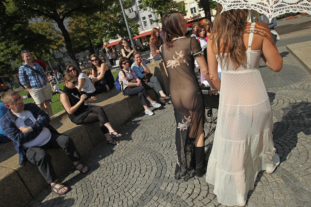 "BERLIN, GERMANY - AUGUST 13:  (EDITORS NOTE: Image contains nudity.) A man stares at two women who are naked under their very thin outfits and who are arriving for the ""Slut Walk"" march on August 13, 2011 in Berlin, Germany. Several thousand men and women turned out to protest against rape and a woman's right to her body.  (Photo by Sean Gallup/Getty Images)"