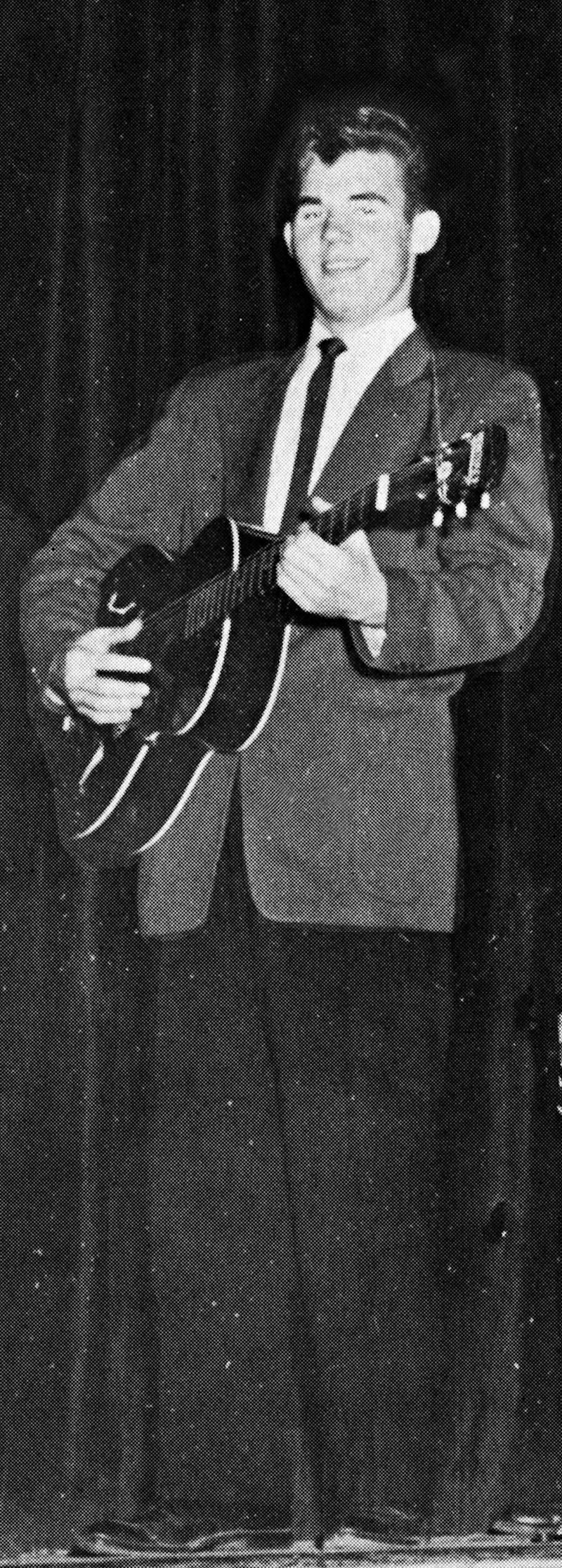 Kenny Rogers performing in a talent show during his senior year at Jefferson Davis High School in Houston, Tex.; 1956