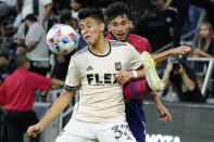 Los Angeles FC defender Marco Farfan, left, defends on Dallas FC forward Ricardo Pepi during the first half of an MLS soccer match Wednesday, June 23, 2021, in Los Angeles. (AP Photo/Marcio Jose Sanchez)