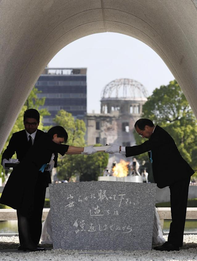 "<p>Hiroshima Mayor Kazumi Matsui, right, hands over the name list of newly added people who died of the world's first atomic bombing over the past year during a ceremony to mark the 72nd anniversary of the 1945 bombing that killed 140,000 people, at the Peace Memorial Park in Hiroshima, western Japan, Sunday, Aug. 6, 2017. ""This hell is not a thing of the past,"" Matsui said in his peace declaration at Sunday's ceremony. ""As long as nuclear weapons exist and policymakers threaten their use, their horror could leap into our present at any moment. You could find yourself suffering their cruelty."" (Photo: Shohei Miyano/Kyodo News via AP) </p>"