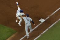 Tampa Bay Rays first baseman Ji-Man Choi tags out Los Angeles Dodgers' Austin Barnes during the third inning in Game 6 of the baseball World Series Tuesday, Oct. 27, 2020, in Arlington, Texas. (AP Photo/David J. Phillip)
