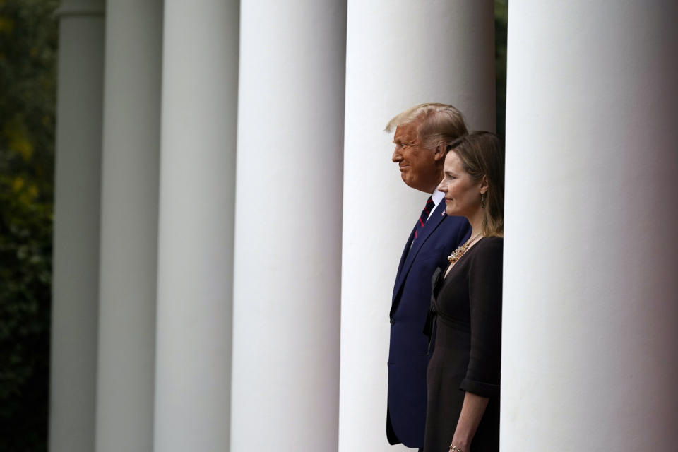 President Trump walks with Judge Amy Coney Barrett to a news conference