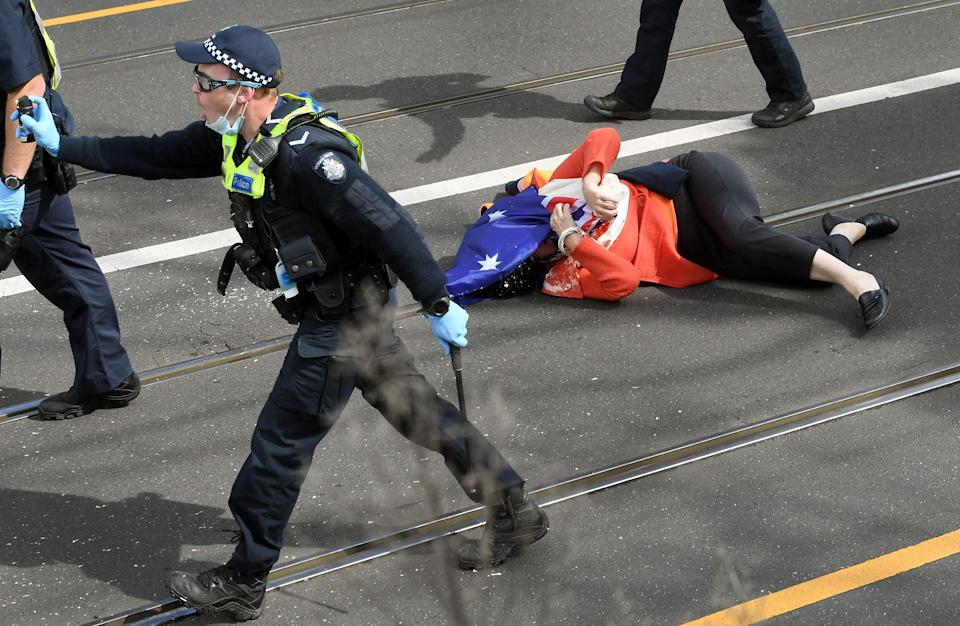 A protester who was pushed to the ground by the police after being pepper sprayed (AFP/Getty)
