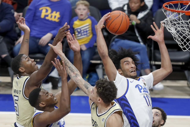 Pittsburgh's Justin Champagnie (11) goes to the hoop to score past Georgia Tech's Moses Wright (5) during the second half of an NCAA college basketball game, Saturday, Feb. 8, 2020, in Pittsburgh. Pittsburgh won 73-64. (AP Photo/Keith Srakocic)