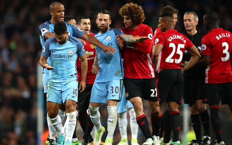 Marouane Fellaini (C) was sent off for headbutting Sergio Aguero (L) - Getty Images Europe