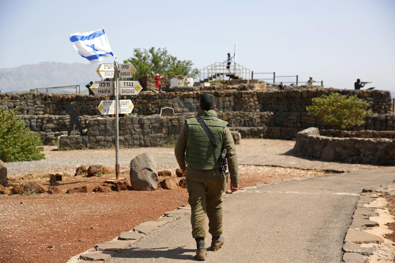 <p>An Israeli soldier walks in an old military outpost, used for visitors to view the Israeli controlled Golan Heights, near the border with Syria, Thursday, May 10, 2018. (Photo: Ariel Schalit/AP) </p>