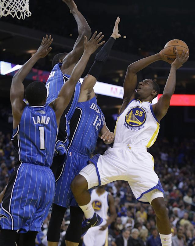 Golden State Warriors' Jordan Crawford, right, shoots against Orlando Magic guard Doron Lamb (1) and forward Tobias Harris (12) during the second half of an NBA basketball game Tuesday, March 18, 2014, in Oakland, Calif. (AP Photo/Ben Margot)