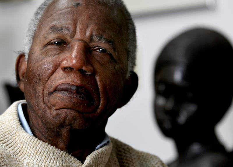 """FILE - Chinua Achebe, Nigerian-born novelist and poet poses his life at his home on the campus of Bard College in Annandale-on-Hudson, New York where he is a professor in this Jan. 22, 2008 file photo. Achebe, who wrote the classic """"Things Fall Apart,"""" has died. He was 82. Achebe's publisher confirmed his death Friday, March 22, 2013. (AP Photo/Craig Ruttle, File)"""