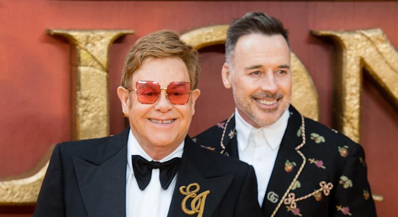 Sir Elton John has revealed he will ever smack or shout at the children he shares with husband David Furnish [Image: Getty]