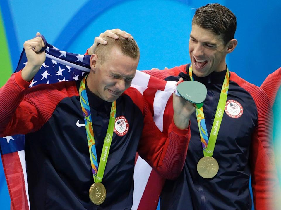 Michael Phelps consoles a crying Caeleb Dressel after the U.S. won the 4x100-meter relay at the Tokyo Olympics