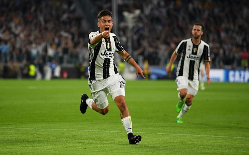 Paulo Dybala of Juventus celebrates after scoring his team's second goal - Credit: GETTY