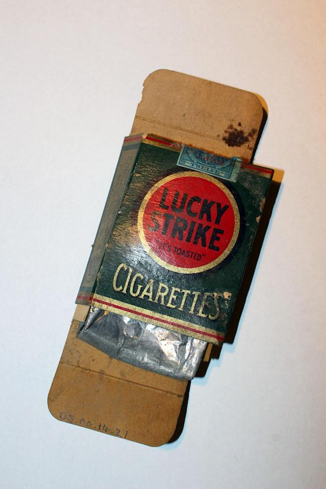 <p>This Lucky Strike package was found under floorboards of an apartment kitchen in 2008. (Photo: Caters News) </p>