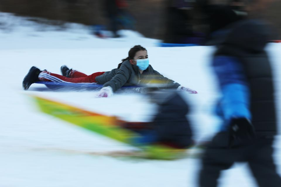 People enjoy an afternoon of sledding at New York's Central Park on Thursday.