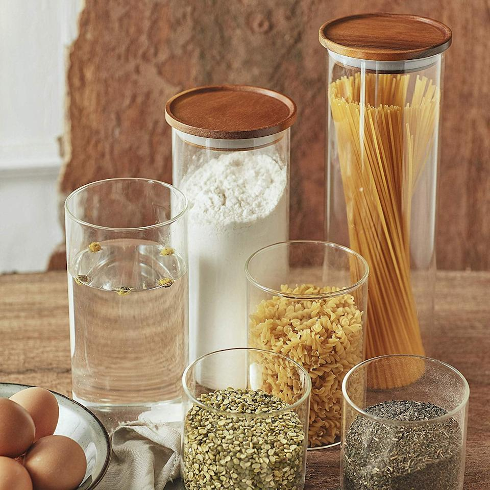 "<p>To create more space and make my cabinets look nicer, I want to invest in this <a href=""https://www.popsugar.com/buy/Essos-Glass-Jars-Wood-Lids-Set-539249?p_name=Essos%20Glass%20Jars%20With%20Wood%20Lids%20Set&retailer=amazon.com&pid=539249&price=40&evar1=casa%3Aus&evar9=47092931&evar98=https%3A%2F%2Fwww.popsugar.com%2Fphoto-gallery%2F47092931%2Fimage%2F47093157%2FEssos-Glass-Jars-With-Wood-Lids-Set&list1=shopping%2Ceditors%20pick%2Corganization%2Ckitchens%2Csmall%20space%20living%2Chome%20organization%2Chome%20shopping&prop13=api&pdata=1"" rel=""nofollow"" data-shoppable-link=""1"" target=""_blank"" class=""ga-track"" data-ga-category=""Related"" data-ga-label=""https://www.amazon.com/dp/B07R8GZMCG/ref=sspa_dk_detail_4?creativeASIN=B07R8GZMCG&amp;linkCode=w50&amp;tag=popsugarshopx-20&amp;imprToken=xUByBS-luK23a9lNt5Xq5A&amp;slotNum=0&amp;pd_rd_i=B07R8GZMCG&amp;pd_rd_w=wPoec&amp;pf_rd_p=45a72588-80f7-4414-9851-786f6c16d42b&amp;pd_rd_wg=vmoMC&amp;pf_rd_r=NDQAYQH7E7XPY6Q91M0T&amp;pd_rd_r=b1328578-a097-49fc-b010-d300f6877cd9&amp;spLa=ZW5jcnlwdGVkUXVhbGlmaWVyPUFXTjBSOElYMVBUV0gmZW5jcnlwdGVkSWQ9QTAzNzQzOTQzVUVWRlZDSktURkJLJmVuY3J5cHRlZEFkSWQ9QTEwMTU0NTgzSjQ1R1BDMVVWUEZFJndpZGdldE5hbWU9c3BfZGV0YWlsJmFjdGlvbj1jbGlja1JlZGlyZWN0JmRvTm90TG9nQ2xpY2s9dHJ1ZQ&amp;th=1"" data-ga-action=""In-Line Links"">Essos Glass Jars With Wood Lids Set</a> ($40).</p>"