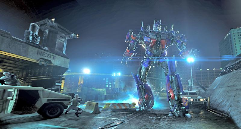 """In this undated image released by Universal Studios Hollywood, the character Optimus Prime are displayed during the """"Transformers the Ride: 3D,"""" attraction at Universal Studios Hollywood in Los Angeles. Debuting May 25 at Universal Studios Hollywood, the ride, based on the film franchise, offers motion-simulator vehicles and 3D high definition video. (AP Photo/Universal Studios Hollywood)"""