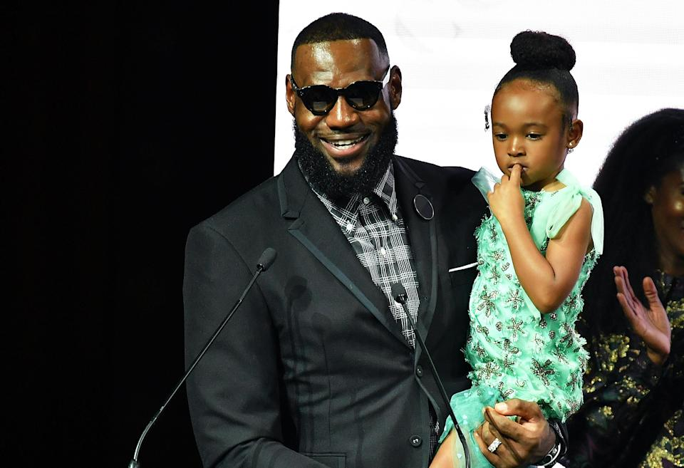 LeBron James, pictured with his daughter, Zhuri, is being dad shamed for not buckling her into a car seat. (Photo: Getty Images)