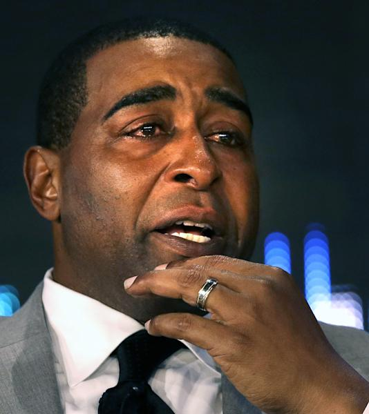 FILE - In this Feb. 2, 2013 file photo, former NFL wide receiver Cris Carter tears up after being selected as a Pro Football Hall of Fame inductee during an announcement in New Orleans. Carter will be inducted into the Pro Football Hall of Fame in Canton, Ohio on Saturday, Aug. 3, 2013. (AP Photo/Gerald Herbert, File)