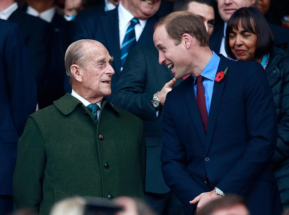 LONDON, ENGLAND - OCTOBER 31:  Prince Harry, Prince Phillip and Prince William enjoy the build up to the 2015 Rugby World Cup Final match between New Zealand and Australia at Twickenham Stadium on October 31, 2015 in London, United Kingdom.  (Photo by Phil Walter/Getty Images)
