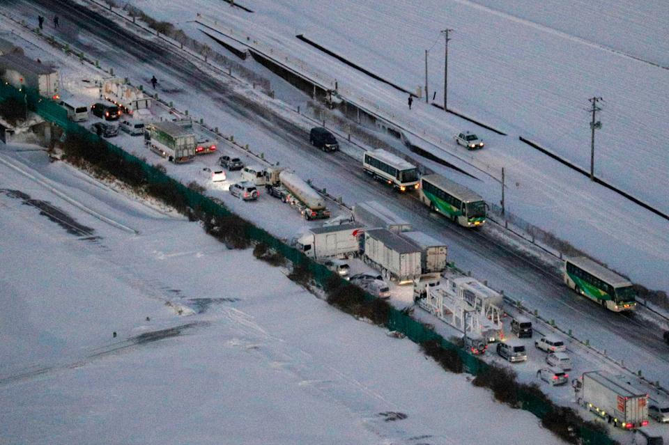 Cars are stuck on the snowy Tohoku Expressway in Osaki cityAP