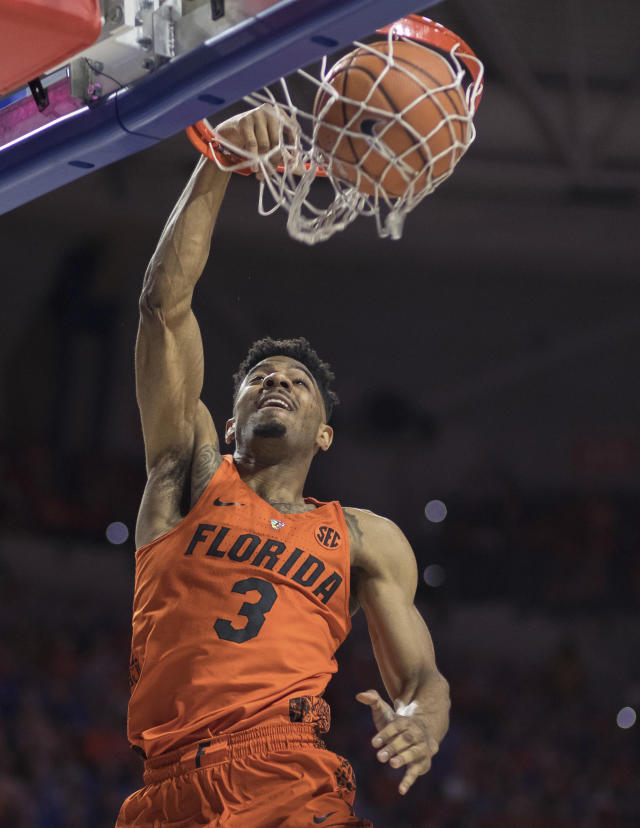 Florida guard Jalen Hudson (3) makes a dunk on a fast break during the first half of an NCAA college basketball game against Kentucky in Gainesville, Fla., Saturday, March 3, 2018. (AP Photo/Ron Irby)