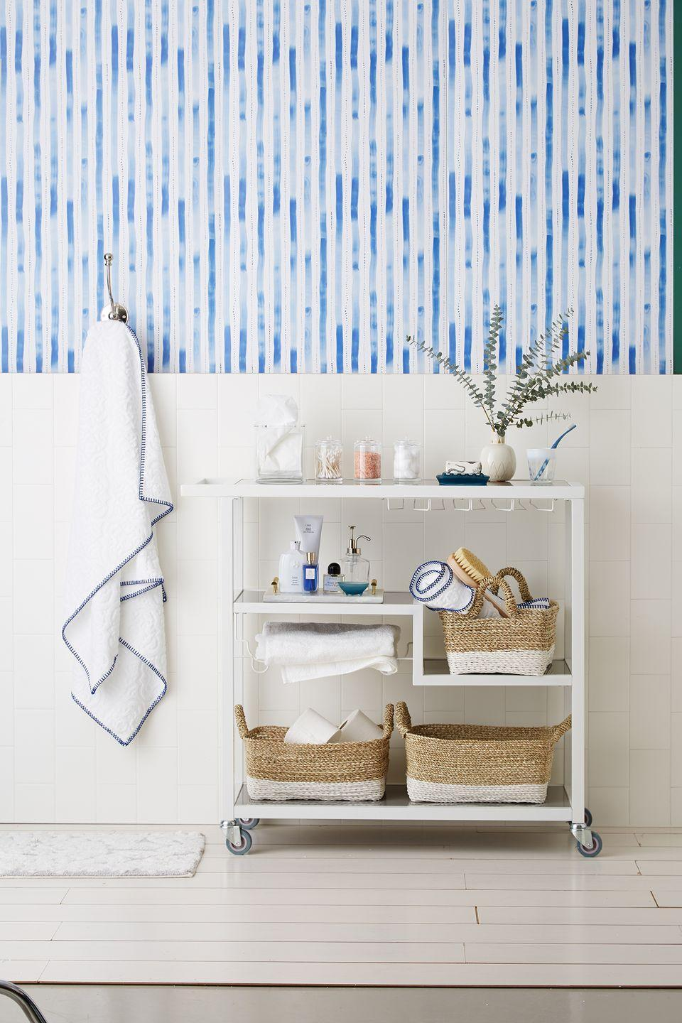 <p>Create a spa-like vibe in your bathroom by styling your bar cart with eucalyptus and woven baskets full of toiletries. </p>