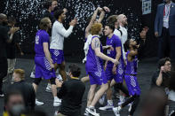 Abilene Christian players celebrate after upsetting Texas 53-52 in a college basketball game in the first round of the NCAA tournament at Lucas Oil Stadium in Indianapolis Sunday, March 21, 2021. (AP Photo/Mark Humphrey)