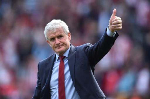 Mark Hughes has been rewarded for keeping Saints in the Premier League