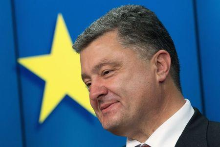Ukraine's President Poroshenko smiles as he speaks during news conference at EU Council in Brussels