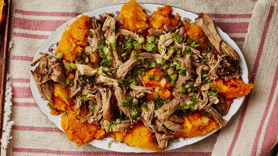 "Bone-in pork shoulder is one of the least expensive, party-friendly animal proteins you can buy. Boneless will work for this recipe as well, but it will cook through a bit quicker. If you end up with skin-on pork shoulder, either take it off yourself—easy to do with a sharp knife and a <a href=""https://www.youtube.com/watch?v=bqqdHi9WLAs"" rel=""nofollow noopener"" target=""_blank"" data-ylk=""slk:YouTube video"" class=""link rapid-noclick-resp"">YouTube video</a>—or simply cook it with the skin on and remove it after the pork is fully cooked. This pork is the star of the $50 dinner party; <a href=""http://www.bonappetit.com/story/50-dollar-dinner-party-pork-shoulder?mbid=synd_yahoo_rss"" rel=""nofollow noopener"" target=""_blank"" data-ylk=""slk:see the rest of the menu here."" class=""link rapid-noclick-resp"">see the rest of the menu here.</a> <a href=""https://www.bonappetit.com/recipe/cider-braised-pork-shoulder-with-butternut-squash?mbid=synd_yahoo_rss"" rel=""nofollow noopener"" target=""_blank"" data-ylk=""slk:See recipe."" class=""link rapid-noclick-resp"">See recipe.</a>"