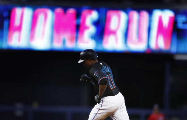 Miami Marlins' Curtis Granderson (21) runs to third base after he hits a home run during the fifth inning of a baseball game against the Washington Nationals on Saturday, April 20, 2019, in Miami. (AP Photo/Brynn Anderson)