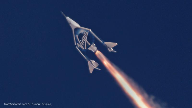 A Virgin Galactic spaceship boosting into the sky