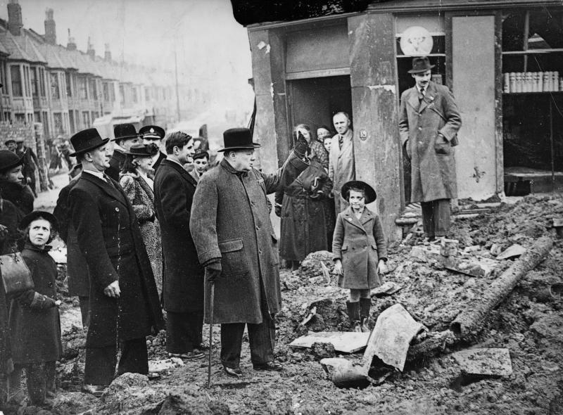 Prime Minister Winston Churchill, with his wife and the American ambassador, visits the bombed city of Bristol, England in April, 1941. (Photo by © Hulton-Deutsch Collection/CORBIS/Corbis via Getty Images)