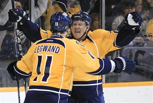 Nashville Predators right wing Patric Hornqvist, right, of Sweden, right, celebrates with David Legwand (11) after Hornqvist scored against the Los Angeles Kings in the second period of an NHL hockey game Monday, Feb. 27, 2012, in Nashville, Tenn. (AP Photo/Mark Humphrey)