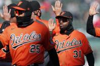 Baltimore Orioles' Cedric Mullins (31) and Anthony Santander (25) celebrate after defeating the Boston Red Sox baseball game, Saturday, April 3, 2021, in Boston. (AP Photo/Michael Dwyer)