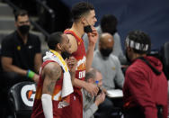 Denver Nuggets guard Monte Morris, front, and forward Michael Porter Jr. pull down their face masks to celebrate as time runs out in the team's NBA basketball game against the Miami Heat on Wednesday, April 14, 2021, in Denver. (AP Photo/David Zalubowski)