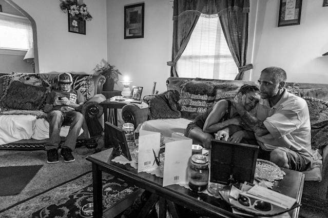 Larry Fugate, left, a recovering heroin addict at home in Middletown, Ohio. Five months ago, his mom Terri Fugate resuscitated him after a heroin overdose. His mother sits with her fiancé, Gene Robinson, also a recovering heroin addict. (Photograph by Mary F. Calvert for Yahoo News)