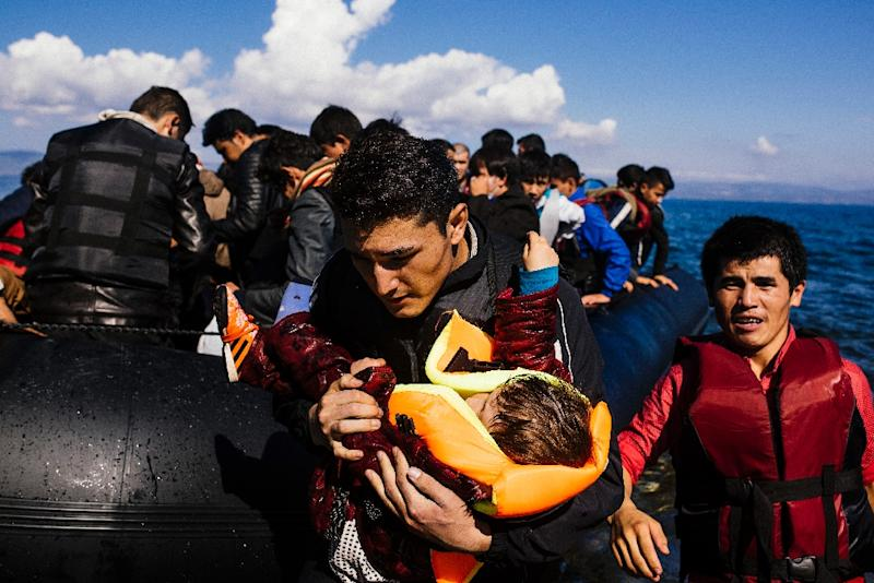 Migrants and refugees arrive on the Greek island of Lesbos after crossing the Aegean Sea from Turkey, in October 2015 (AFP Photo/Dimitar Dilkoff)
