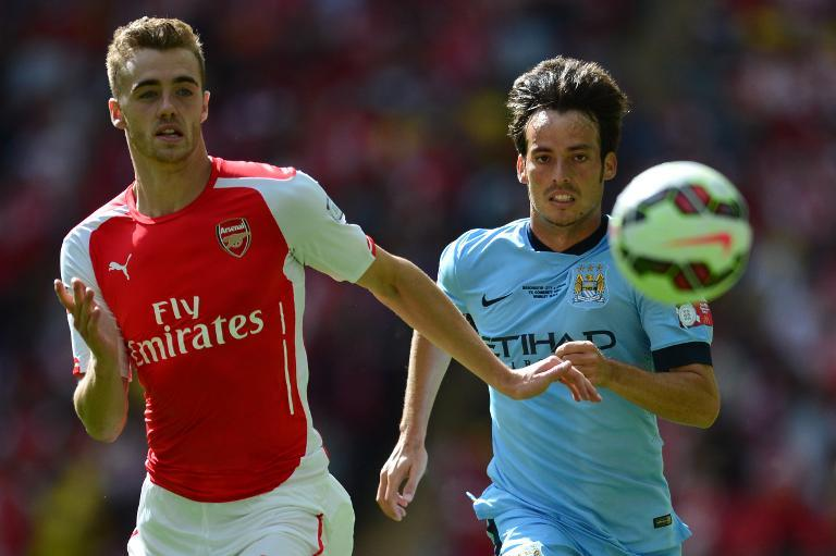 Arsenal's English defender Calum Chambers (L) gets away from Manchester City's Spanish midfielder David Silva during the FA Community Shield at Wembley Stadium in north London on August 10, 2014