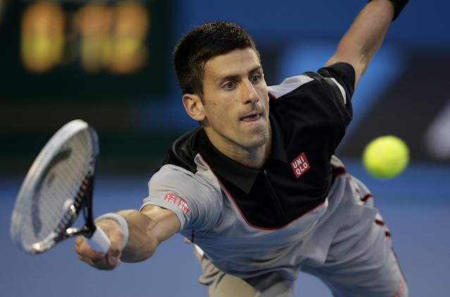Novak Djokovic of Serbia makes a forehand return to Stanislas Wawrinka of Switzerland during their quarterfinal at the Australian Open tennis championship in Melbourne, Australia, Tuesday, Jan. 21, 2014.(AP Photo/Rick Rycroft)