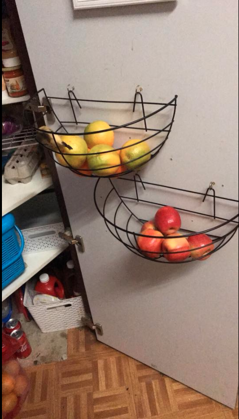 For those with little space, one mum hung two plant baskets inside her pantry door to keep her fruit nice and fresh. Photo: Facebook/Kmart Mums Australia