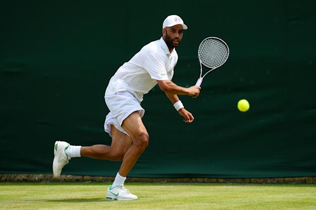 LONDON, ENGLAND - JUNE 27: James Blake of the United States of America plays a backhand during his Gentlemen's Singles second round match against Bernard Tomic of Australia on day four of the Wimbledon Lawn Tennis Championships at the All England Lawn Tennis and Croquet Club on June 27, 2013 in London, England. (Photo by Mike Hewitt/Getty Images)