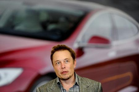 FILE PHOTO: Tesla Chief Executive Office Elon Musk speaks at his company's factory in Fremont, California, U.S., June 22, 2012. REUTERS/Noah Berger/File Photo
