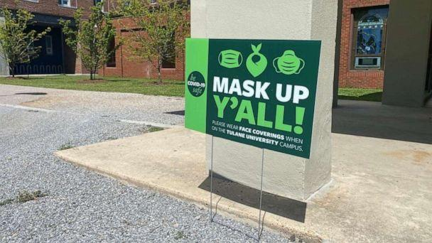 PHOTO: In this June 21, 2020, file photo, signs remind members to wear masks to prevent the spread of COVID-19 at Tulane University in New Orleans. (Catherine Koppel/Reuters, FILE)