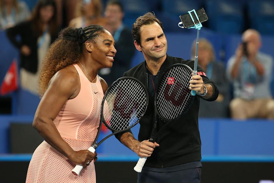 Roger Federer beat Serena Williams in a mixed-doubles exhibition match on Tuesday, but there were no hard feelings when it was over. (Paul Kane/Getty Images)